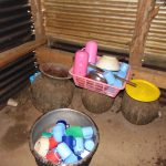 The Water Project: St. Joaim Buyangu Primary School -  Washed Utensils Drying Over Water Storage Pots