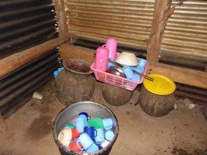 The Water Project:  Washed Utensils Drying Over Water Storage Pots