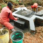 The Water Project: Malimali Community, Shamala Spring -  Securing Discharge Pipes