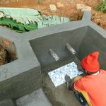 The Water Project: Malimali Community, Shamala Spring -  Tile Setting