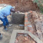 The Water Project: Shivembe Community, Murumbi Spring -  Cementing A Wall