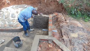 The Water Project:  Cementing A Wall