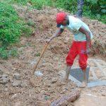 The Water Project: Kimarani Community, Kipsiro Spring -  Soil Backfilling Over Tarp