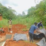 The Water Project: Shikhombero Community, Atondola Spring -  Adding Plastic Tarp