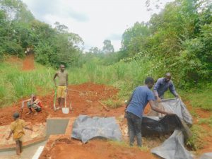 The Water Project:  Adding Plastic Tarp