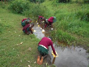The Water Project:  Studentss At The River Collecting Water