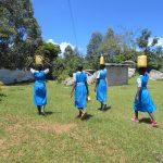 The Water Project: Gimarakwa Primary School -  Pupils Carrying Water To School