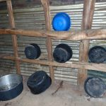 The Water Project: St. Joaim Buyangu Primary School -  Kitchen Wall Used As Dishrack