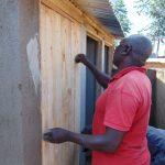 The Water Project: Banja Secondary School -  Fitting Latrine Doors