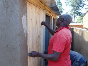 The Water Project:  Fitting Latrine Doors