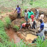 The Water Project: Malimali Community, Shamala Spring -  Community Helps Backfill With Clay