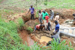 The Water Project:  Community Helps Backfill With Clay