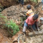 The Water Project: Malimali Community, Shamala Spring -  Moulding Clay Backfilling