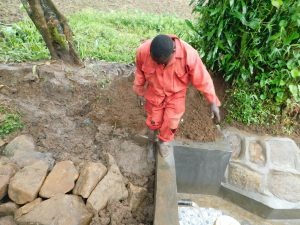 The Water Project:  Adding Clay To Backfilling