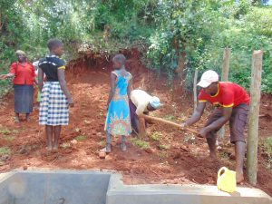 The Water Project:  Planting Grass And Digging Fence Holes