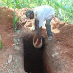 The Water Project: Kisasi Community, Edward Sabwa Spring -  Community Member Digging A Latrine Pit