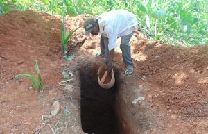 The Water Project:  Community Member Digging A Latrine Pit