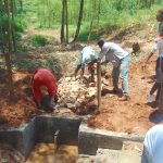 The Water Project: Shivembe Community, Murumbi Spring -  Stone Backfilling