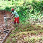 The Water Project: Kimarani Community, Kipsiro Spring -  Kids Hand Artisan Grass To Plant