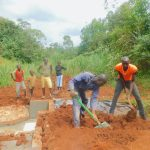 The Water Project: Shikhombero Community, Atondola Spring -  Backfilling With Soil