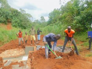 The Water Project:  Backfilling With Soil