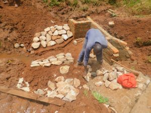 The Water Project:  Rub Wall Stone Pitching