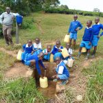 The Water Project: Jamulongoji Primary School -  Students Fetching Water