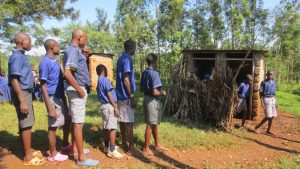 The Water Project:  Boys Lined Up To Use Latrines