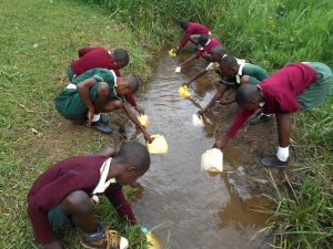 The Water Project:  Students Collecting Water At The Stream