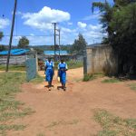 The Water Project: Gimarakwa Primary School -  Students Carrying Water To School