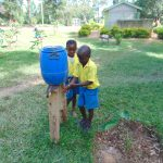 The Water Project: Shikomoli Primary School -  Pupils Use A Handwashing Station
