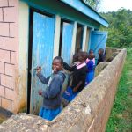 The Water Project: St. Joaim Buyangu Primary School -  Girls In Line For Latrines
