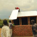 The Water Project: Mukama Primary School -  Adding Metal Roofing