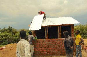 The Water Project:  Adding Metal Roofing