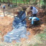 The Water Project: Shivembe Community, Murumbi Spring -  Adding Tarp Over Stones