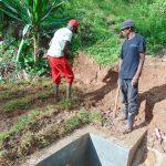 The Water Project: Kimarani Community, Kipsiro Spring -  Grass Planting