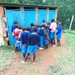 The Water Project: St. Joaim Buyangu Primary School -  Boys In Line For Latrines