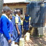 The Water Project: Jimarani Primary School -  Fetching Water From Small Tank