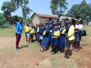 The Water Project:  Field Officer Stanley Points Out Features Of The Rain Tank To Students