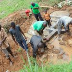 The Water Project: Malimali Community, Shamala Spring -  Laying Stone Backfilling