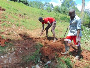 The Water Project:  Digging Cut Off Drainage