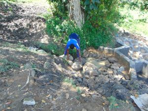 The Water Project:  Backfilling With Stones
