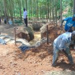 The Water Project: Shivembe Community, Murumbi Spring -  Adding Soil Over Tarp