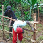 The Water Project: Kimarani Community, Kipsiro Spring -  Constructing Fence To Protect Spring Box