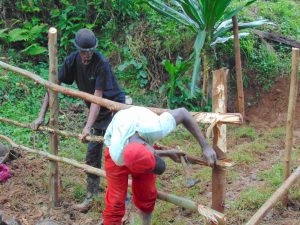 The Water Project:  Constructing Fence To Protect Spring Box