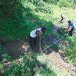 The Water Project: Buyangu Community, Mukhola Spring -  Measuring Foundation