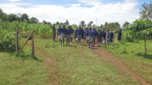The Water Project:  Pupils Arrive Carrying Water Containers