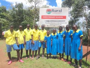 The Water Project:  Pupils Posing Next To Signpost