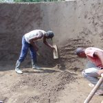 The Water Project: Kosiage Primary School -  Cementing Inside The Tank