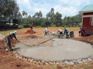 The Water Project:  Pouring Cement Foundation